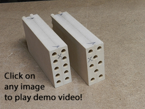 View of multiple bore end of double and triple row dowel woodworking joints.