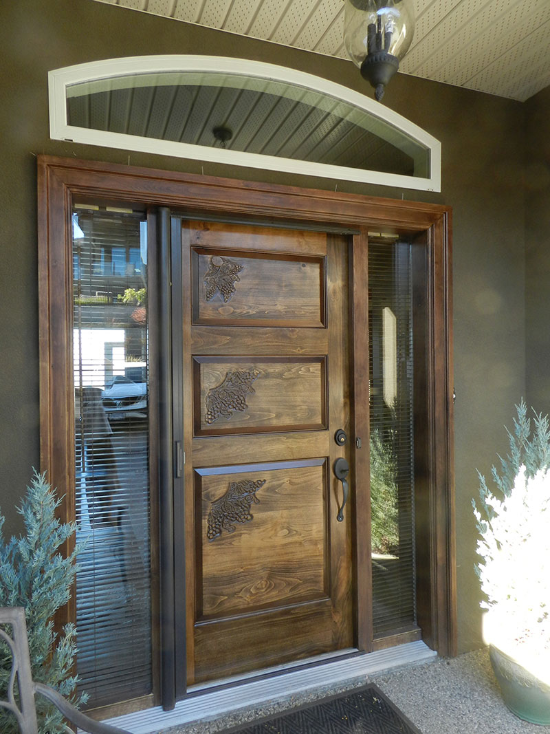 Photograph of the front door that I built twelve years ago with 100% dowel construction after refinishing and reinstalling in August 2017